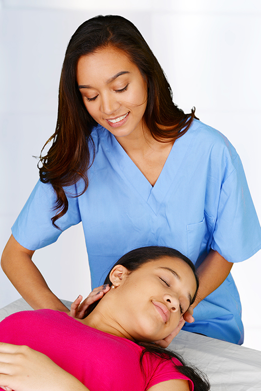 image of Female chiropractor to demonstrate chiropractic care at our Central City Community Health Centers