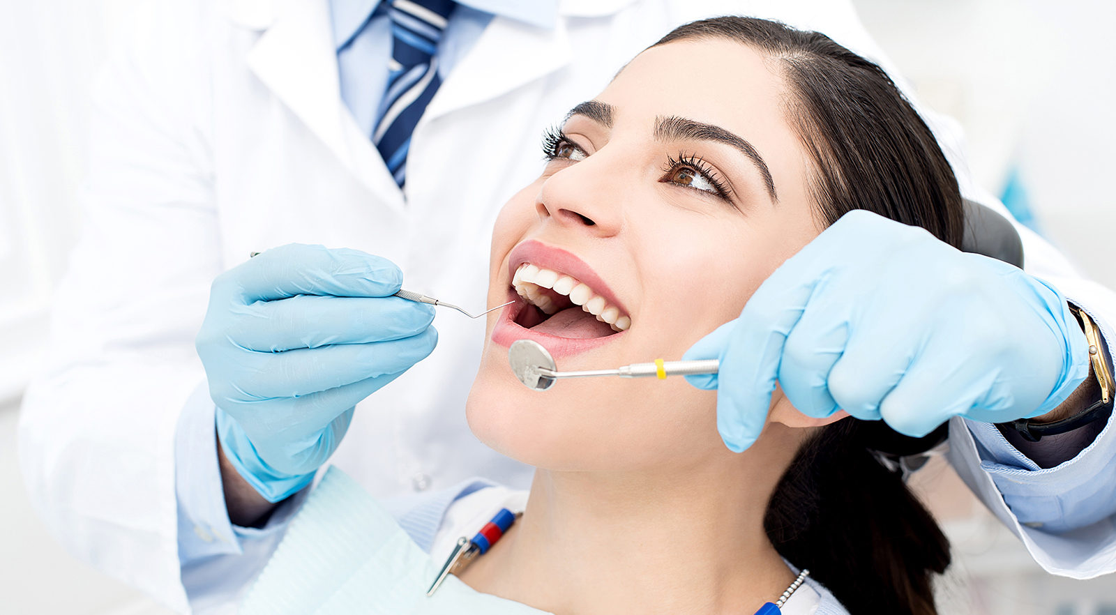 image of Patient having teeth examined for Dentistry page for CCCHC site