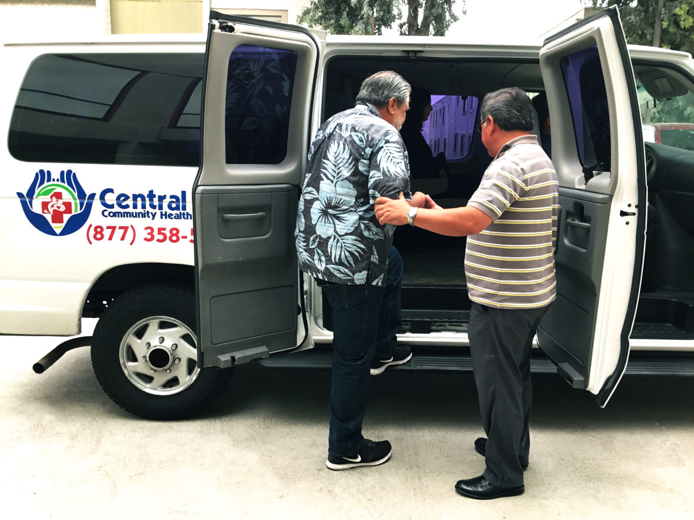 Central City Community Health Centers now has transportation at our clinics. Ask for information from your local CCCHC. One of our drivers giving a step up into our transport van and headed to a Central City Clinic