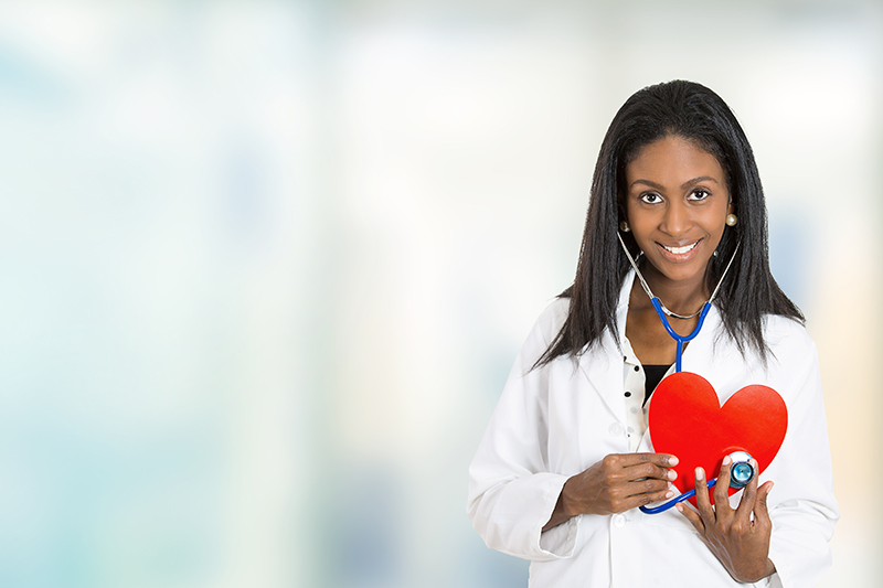 Doctor holding Red Heart and Stethoscope for Pediatrics at Central City Community Health Centers