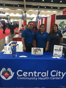 The staff at Central City Community in the booth at Telemundo Event