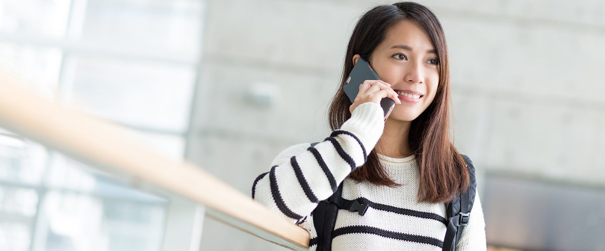 Image with young lady on the phone for display on Make an Appointment
