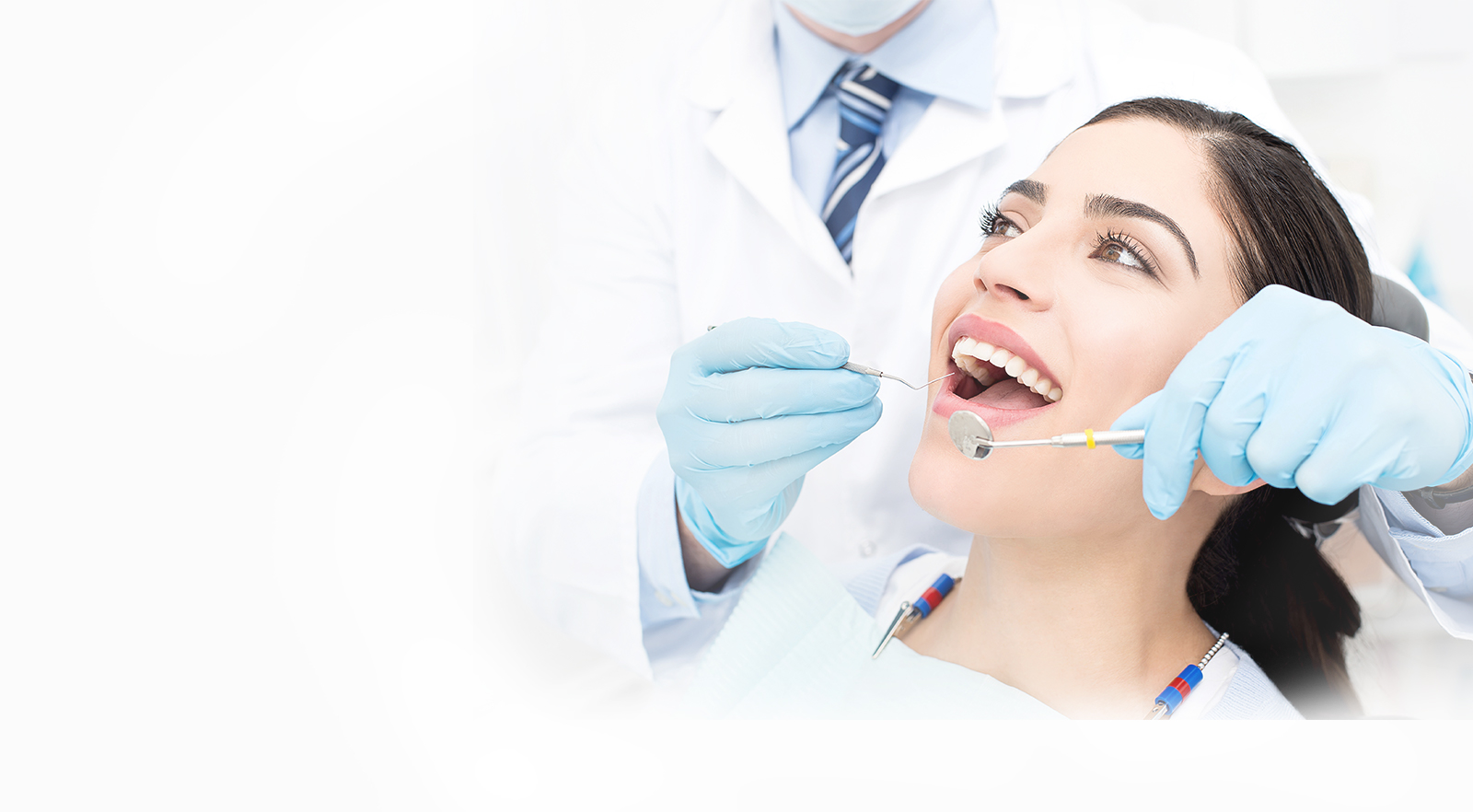 Slider Image of Girl getting Dental Checkup