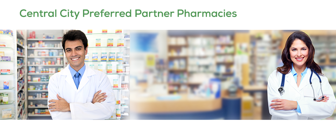 Image of a blurred out pharmacy in the background with a male and female doctor for CCCHC preferred partner pharmacy
