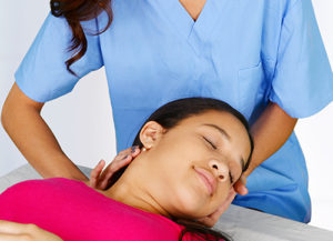 image of chiropractor working on the neck of a patient