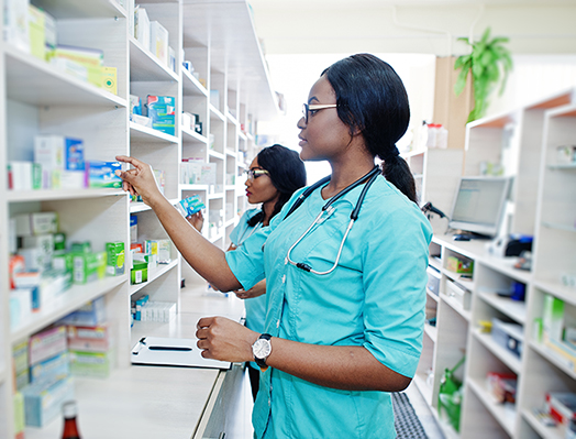 image of Two African american pharmacist working in a pharmacy image for Central City Community Clinic Health Clinic with On-Site Pharmacy