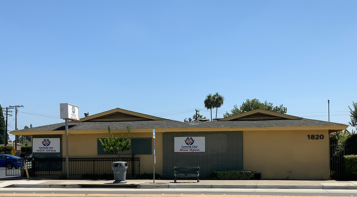 Larger file of 1820 W. Lincoln Central City Community Health clinic on a sunny blue sky day with the signage